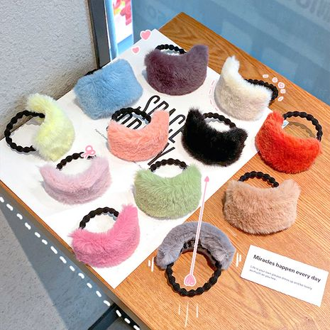 Korean rabbit fur hair rope curved plush hair circle thick rubber band hair rope wholesale NHNA258261's discount tags