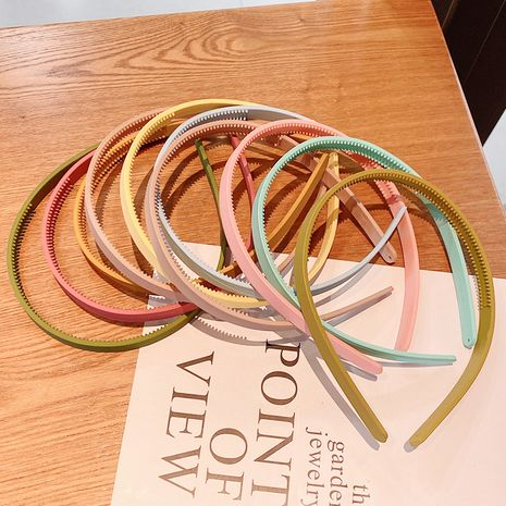 Korean candy-colored wash hairband five packs of thin-edged solid color headbands wholesale NHNA258278's discount tags