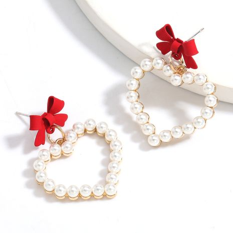 Fashion alloy spray paint bow love heart-shaped imitation pearl earrings wholesale NHJE258330's discount tags