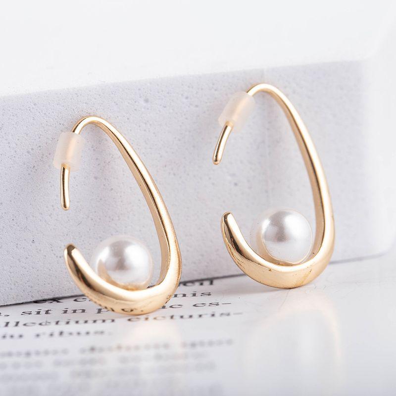 Nouvelles boucles d39oreilles de mode en mtal en laiton perl pour femmes vente en gros NHQS258340