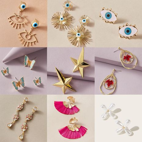 Pendientes de aleación de perlas de flores simples de mariposa de ojo de diablo de moda para mujeres NHGY258512's discount tags