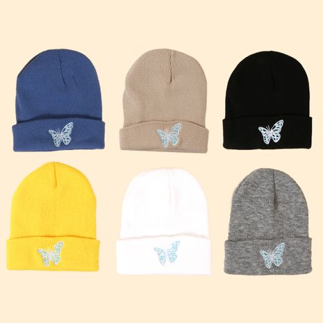Hot selling fashion Pure color knitted embroidery butterfly warm woolen hat wholesale NHTQ258778's discount tags