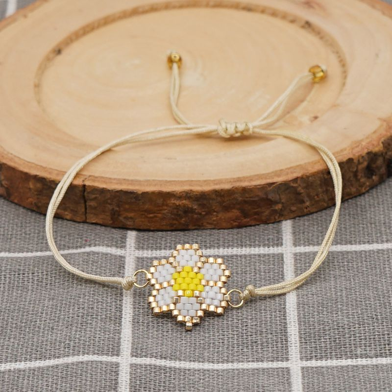Bohemian style fashion creative rice beads hand-woven small daisy bracelet  NHGW259237