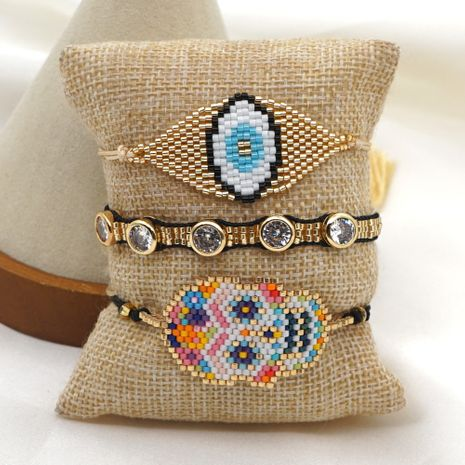 Fashion punk style skull ethnic rice bead woven bracelet hot-saling wholesale NHGW259259's discount tags