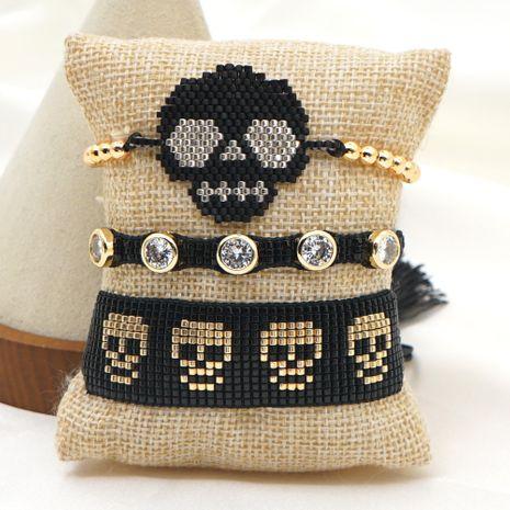 Fashion rice bead woven punk style diamond couple skull bracelet NHGW259283's discount tags
