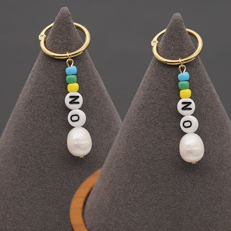 Hot selling fashion personality wild rice beads letter earrings NHGW259289's discount tags