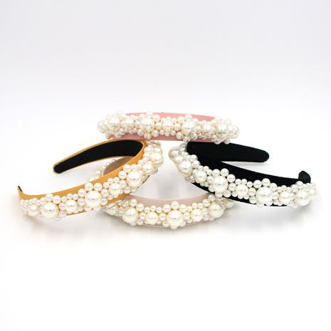 Hot selling fashion headband woven big pearl headband wholesale NHCO259348's discount tags