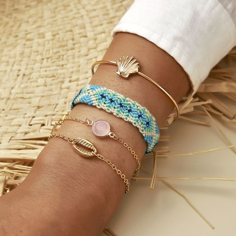 Hot selling fashion fan-shaped shell string hand-woven bracelet set NHGY259499's discount tags
