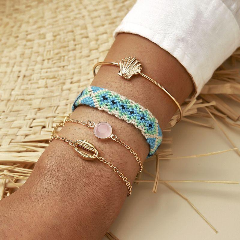 Hot selling fashion fan-shaped shell string hand-woven bracelet set NHGY259499