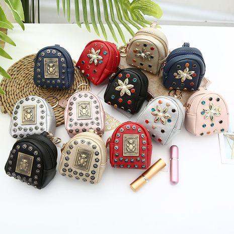 Corée créative rivet mini sac à dos dames pu ours fleur porte-monnaie en gros NHAE259661's discount tags