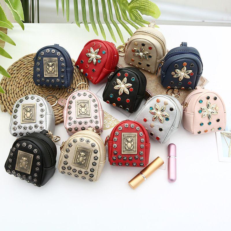 Korea  creative rivet mini backpack ladies pu bear flower coin purse  wholesale NHAE259661
