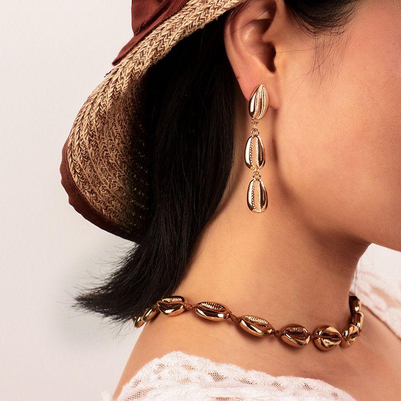 Fashion tassel long shell exaggerated bohemian style alloy earrings NHRN260345