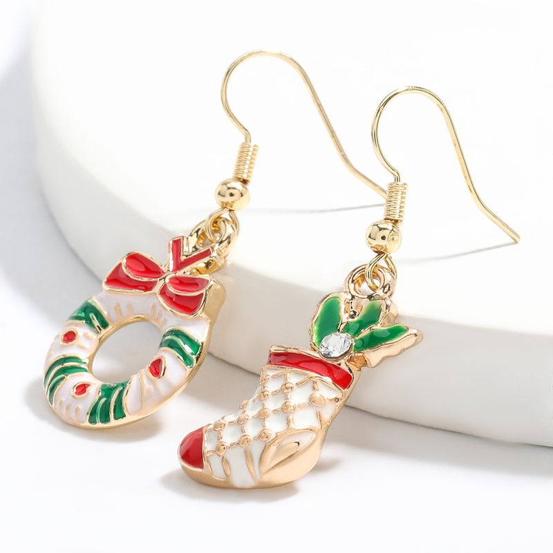 Hot selling fashion alloy drip oil Christmas boots wreath earrings wholesale NHJE260567