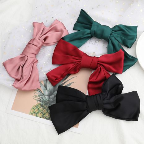 Hot selling fashion ribbon big bow hairpin girl hair accessories spring clip NHJE260570's discount tags