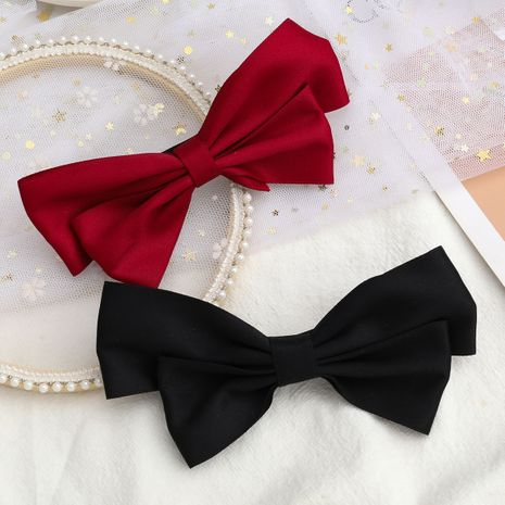 Hot selling fashion ribbon bow hairpin wholesale NHJE260575's discount tags