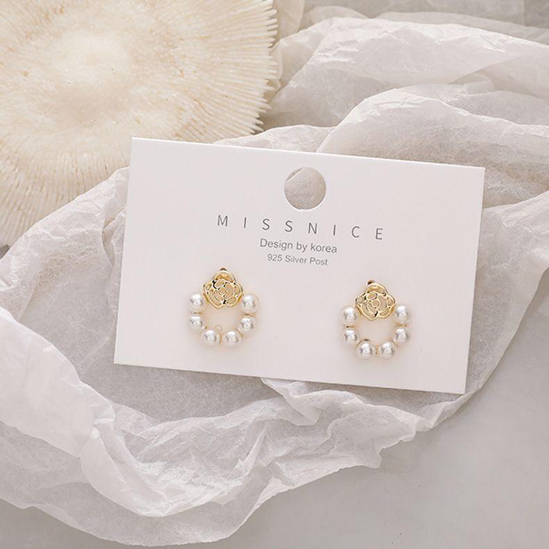 S925 silver needle hollow rose flower pearl retro Korean simple new earrings for women NHMS260687