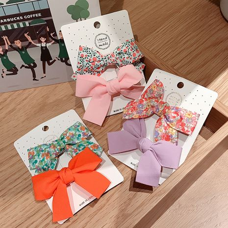 Korea  floral bow hairpin children's duckbill clip set  NHDQ261020's discount tags