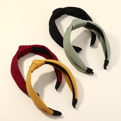 Korean creative fashion  solid color wide side knotted headband wholesale NHAU261085's discount tags