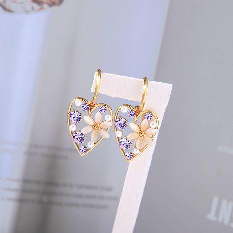 Pendientes de flores huecas de diamantes de aguja de plata en forma de amor s925 de moda NHQD261223's discount tags