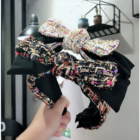 Hot selling fashion woolen women's headband wholesale NHUX261285's discount tags