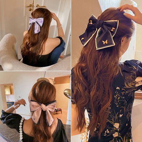 Clip de tête arrière d'impression de tissu coréen mignon gros noeud NHUX261298's discount tags