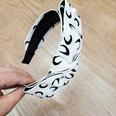 NHUX1140457-Black-crescent-bow-headband
