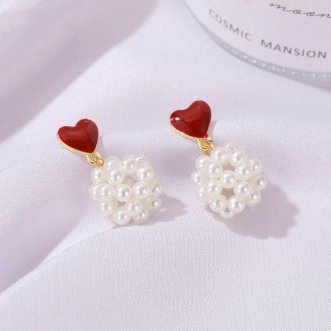 Korean new sweet love pearl  peach heart hollow millet ball alloy earrings NHDP260868's discount tags