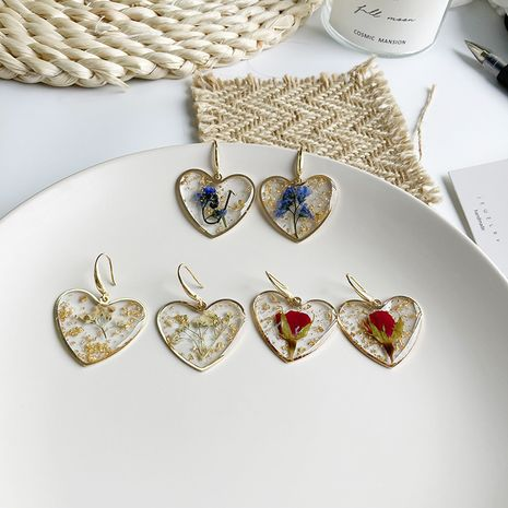 Trendy  Heart-shaped Silicone Flower Plastic Sealing Fresh Korean New Earrings NHWF261423's discount tags