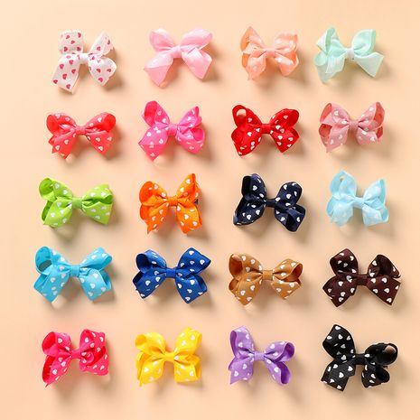 Hot selling fashion mixed color bow hairpins wholesale NHNU262545's discount tags