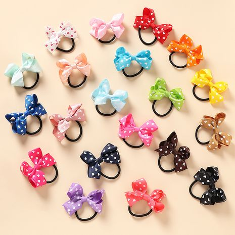 Hot selling fashion color bow  peach heart Hair Scrunchies NHNU262550's discount tags