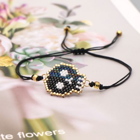 fashion new ethnic style rice bead woven Halloween skull bracelet NHGW261833's discount tags