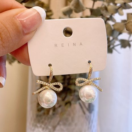 Korea diamond bow pearl new earrings  hot-saling wholesale NHXI261988's discount tags