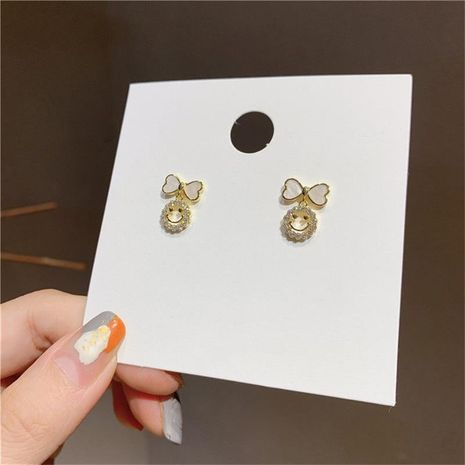 Korea S925 silver needle micro-inlaid zircon smiley face bow earrings NHXI262007's discount tags