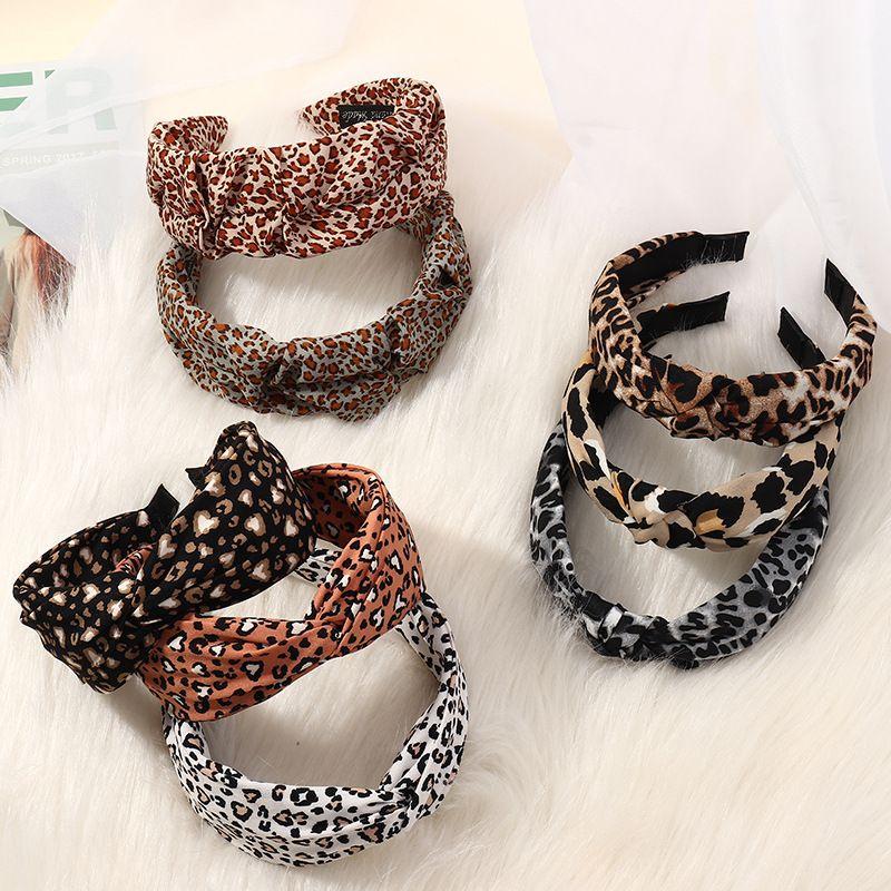 Korean widebrimmed leopard print cross headband NHAU262044