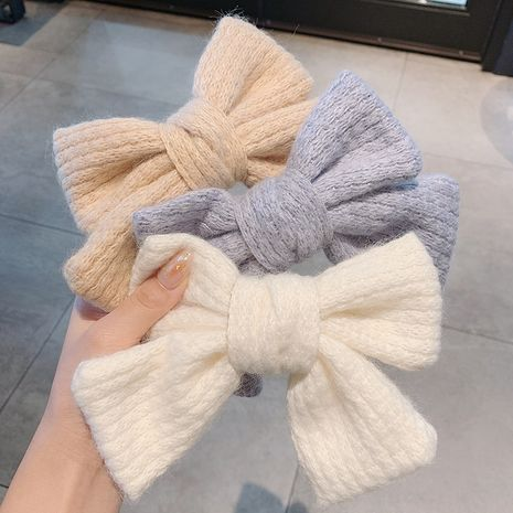 Korea new big bow cute furry knitted hairpin  NHCQ262631's discount tags