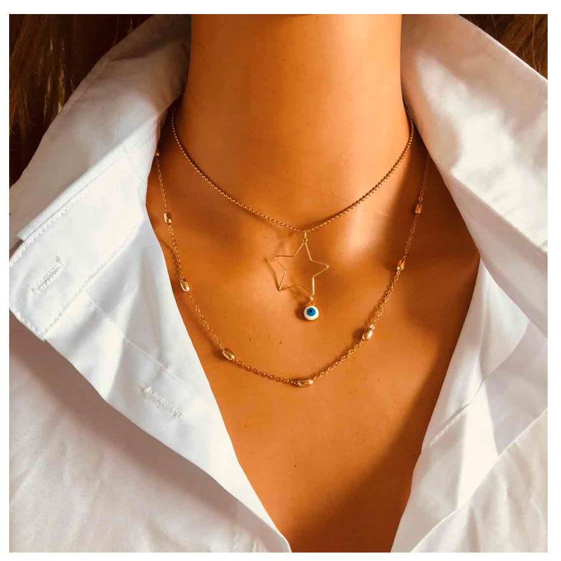 simple retro gold star small eyes pendant necklace multilayer alloy necklace NHCT263197