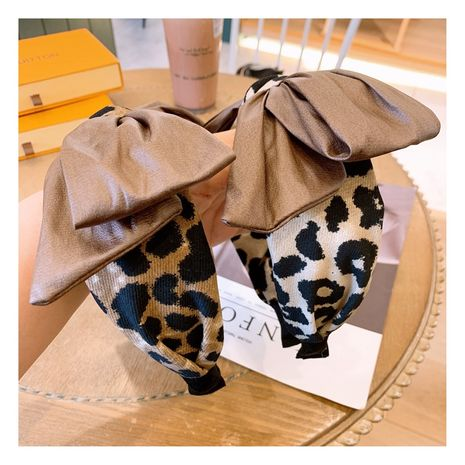 Korean leopard print big bow versatile headband wholesale NHHD263760's discount tags