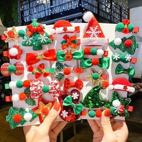 New Christmas Bowknot Christmas Tree Snowflake Old Man Duckbill Clip Child Cute Hair Accessories Hairpin Set NHNA263775's discount tags