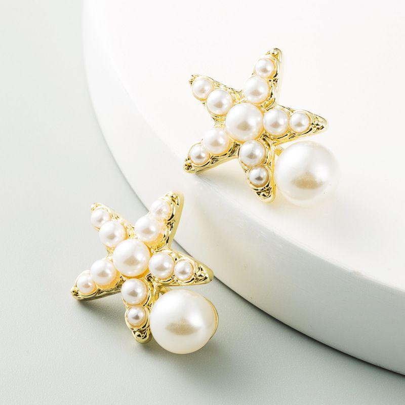 Koreanische neue Mode einfache fnfzackige Stern Seesternlegierung eingelegte Perle S925 Ohrringe NHLN263859
