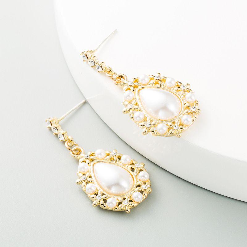 new fashion alloy drop-shaped pearl S925 silver needle diamond light luxury earrings NHLN263862