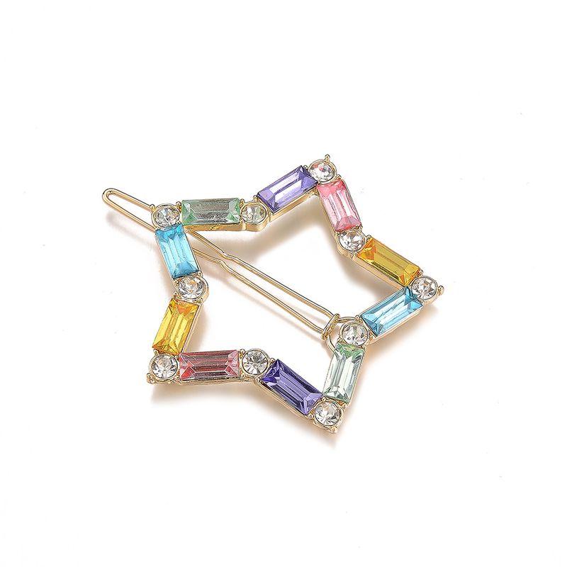 Venta caliente nueva aleación con incrustaciones de color diamante clip lateral simple pinza de pelo de estrella de cinco puntas NHOA263942