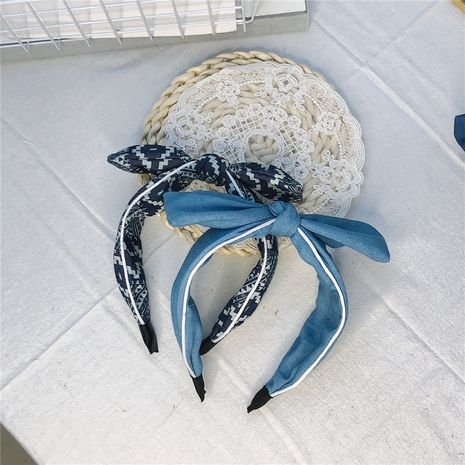 Korea's new single-layer bowknot fabric simple clip-side denim wide-brimmed headband wholesale NHRH263966's discount tags
