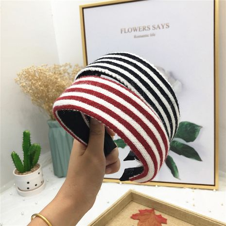 Korea's cashmere wool women's simple fashion striped light board headband wholesale NHRH263973's discount tags