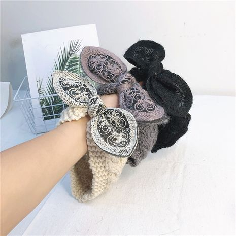 Autumn new Korean wide-brimmed hairband wool simple big bow knitted headband wholesale NHRH263977's discount tags