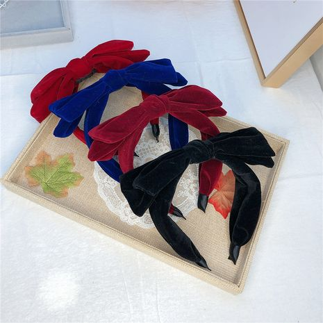 Korean new flannel autumn double-layer big bow broad-sided non-slip simple headband for women wholesale NHRH263979's discount tags