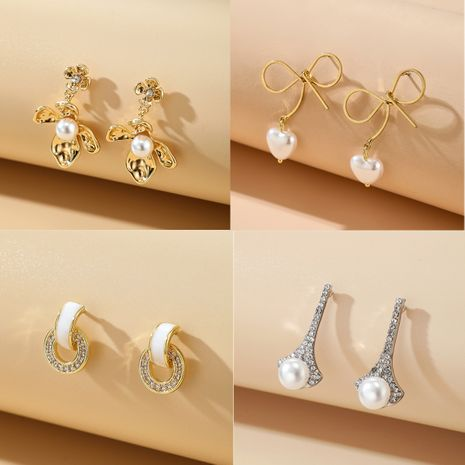 new Korean diamond C-shaped circle petal bow pearl love earrings wholesale NHGY252691's discount tags