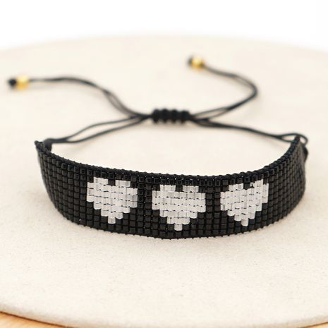 hot-saling antique rice bead woven black and white peach heart couple bracelet  NHGW252804's discount tags