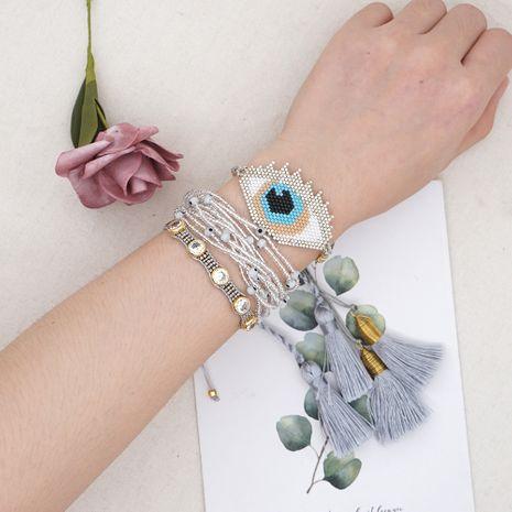 Moda estilo bohemio tendencia granos de arroz ojos tejidos pulsera de borla con cuentas de múltiples capas para mujeres NHGW252818's discount tags