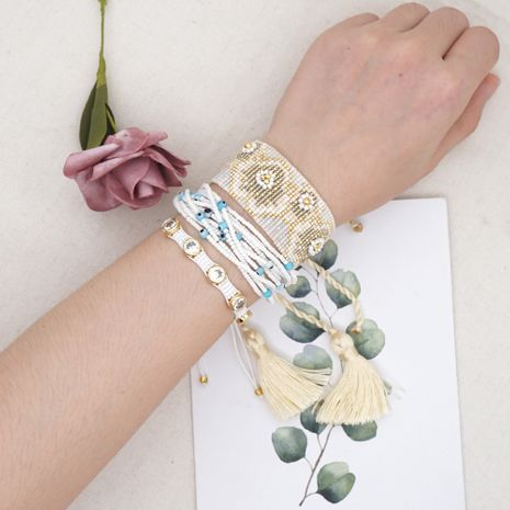 Simple bohemian fashion trend rice beads multi-layer braided beaded suit ethnic style bracelet for women NHGW252819's discount tags