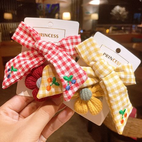 Korean  princess bow  cute flower  plaid fabric cherry hair clip set NHSA252897's discount tags